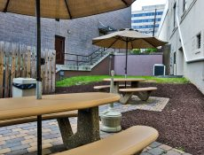 Outdoor patio area with umbrellas and tables where you can sit