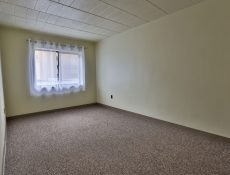 An empty bedroom in a Valley Pike Manor apartment