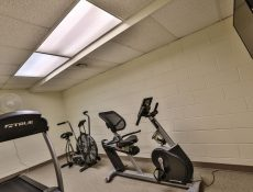 Exercise room with equipment and room for yoga