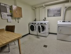 On-site modern laundry facilities with a table and chairs