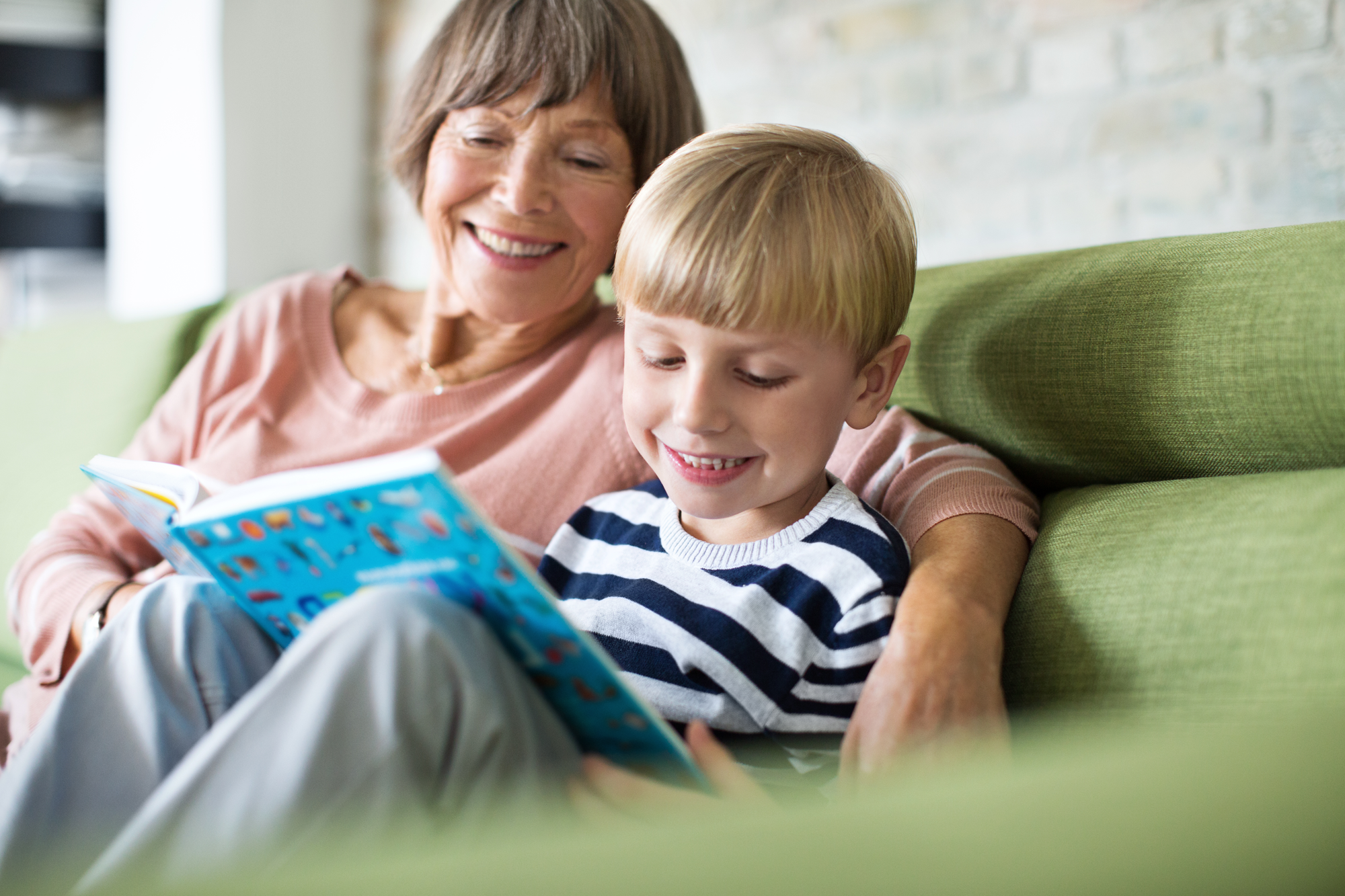 A grandma and grandson reading a book together